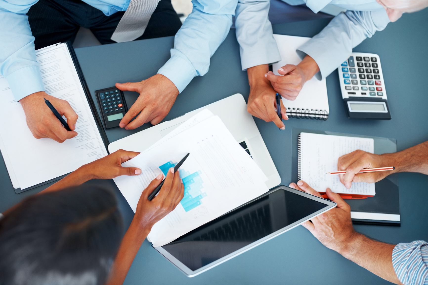 Accounting – Businesspeople Working On Charts And Graphs